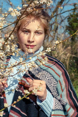 Elly De Vries YOUNG WOMAN BEHIND BLOSSOMS Women