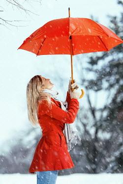 Tijana Moraca HAPPY YOUNG WOMAN IN SNOW Women