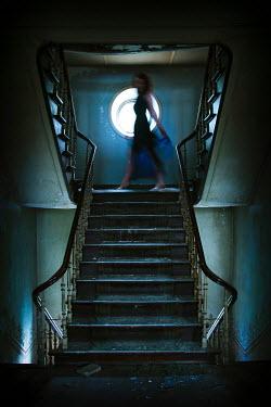 Eva Van Oosten BLURRY WOMAN ON DERELICT STAIRCASE Women