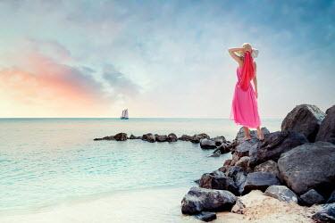 Evelina Kremsdorf WOMAN STANDING ON ROCKS BY SEA Women