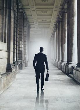 Mark Owen BUSINESSMAN WALKING IN GRAND BUILDING Men