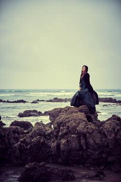 Chris Reeve HISTORIC WOMAN ON ROCKS BY SEA Women