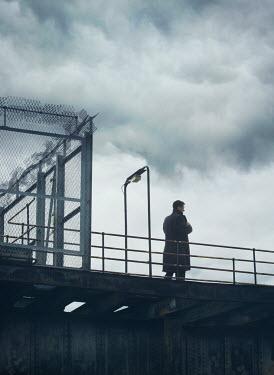 Mark Owen YOUNG MAN STANDING ON BRIDGE Men