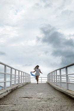 Galya Ivanova YOUNG GIRL RUNNING ON PIER Women