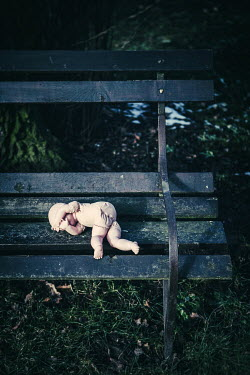 Magdalena Russocka ABANDONED CHILD'S DOLL ON PARK BENCH Miscellaneous Objects
