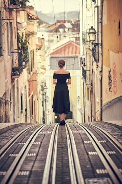 Chris Reeve GLAMOROUS WOMAN STANDING ON TRAM TRACKS Women