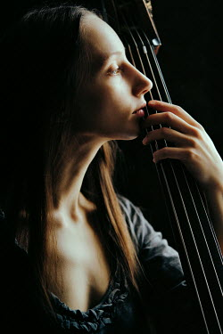 Daniil Kontorovich CLOSE UP OF YOUNG WOMAN WITH CELLO Women