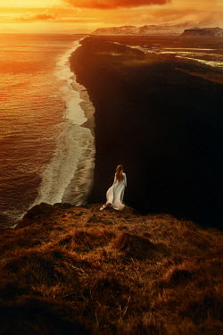Terrence Drysdale YOUNG WOMAN STANDING ON CLIFF BY SEA Women