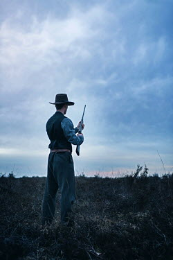 Ysbrand Cosijn COWBOY WITH GUN IN FIELD Men