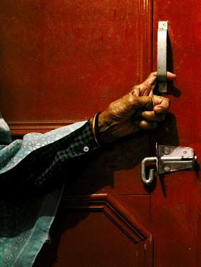 Daniil Kontorovich OLD MAN'S HAND ON DOOR HANDLE Old People