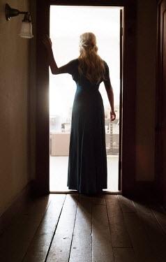 Elisabeth Ansley BLONDE WOMAN STANDING IN DOORWAY Women