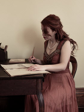 Elisabeth Ansley YOUNG WOMAN AT DESK WRITING Women