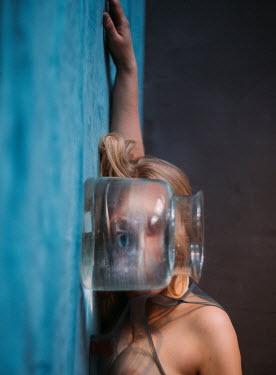 Marta Syrko WOMAN LOOKING THROUGH GLASS JAR Women