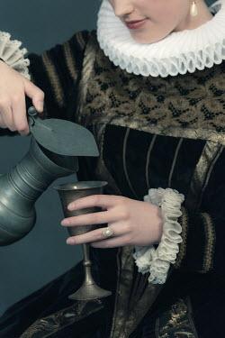 Ysbrand Cosijn HISTORICAL WOMAN POURING INTO GOBLET Women
