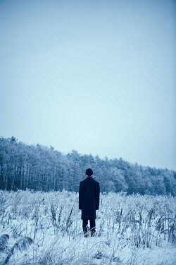 Magdalena Russocka YOUNG MAN STANDING IN SNOWY FIELD Men