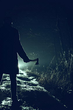 Magdalena Russocka MAN HOLDING AXE ON COUNTRY ROAD Men