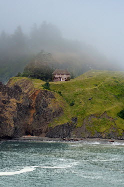 Jill Battaglia THATCHED COTTAGE ON HILL BY OCEAN Houses