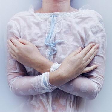 Meg Cowell WOMAN LYING IN MILKY WATER Women