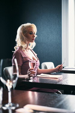 Chris Reeve BEAUTIFUL WOMAN SITTING AT RESTAURANT TABLE Women