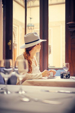 Chris Reeve WOMAN SAT IN CAFE WITH ESPRESSO Women
