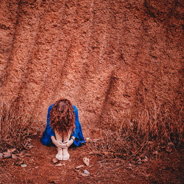 Dasha Pears YOUNG WOMAN SITTING AGAINST RED CLAY HILL Women