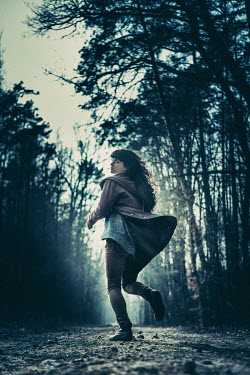 Magdalena Russocka YOUNG WOMAN RUNNING THROUGH WOODS Women