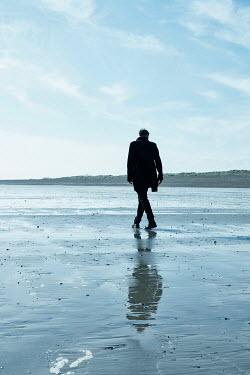 CollaborationJS MAN IN COAT WALKING ON BEACH Men