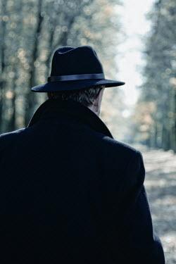 Ilona Wellmann MAN IN HAT IN SUNLIT AVENUE Men
