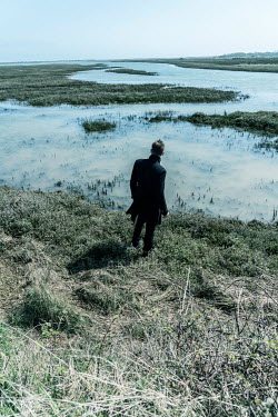 CollaborationJS MAN STANDING BY MARSHES IN WINTER Men