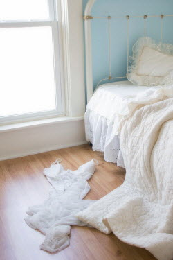 Eleanor Caputo WHITE BED WITH NIGHTDRESS ON FLOOR Interiors/Rooms