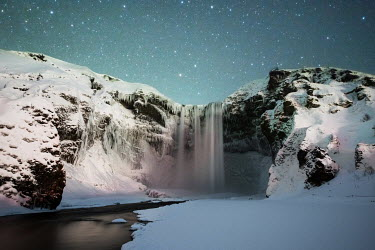 Ollie Taylor FROZEN WATERFALL WITH STARRY SKY Miscellaneous Water