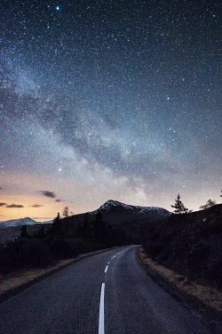 Ollie Taylor ROAD WITH SNOWY MOUNTAINS AND STARRY SKY Roads
