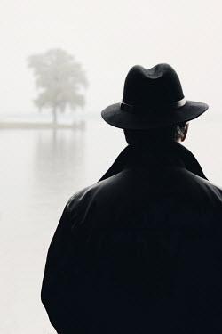 Ilona Wellmann MAN IN HAT WATCHING LAKE Men