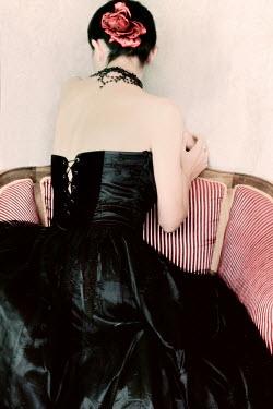 Ilona Wellmann WOMAN IN BLACK SITTING IN CHAIR Women