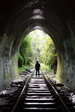 Holly Leedham MAN STANDING IN DISUSED RAILWAY TUNNEL Men