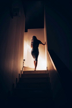 Lena Okuneva YOUNG WOMAN WALKING UP STAIRS Women