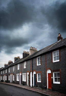 Kyle Stubbs TERRACED HOUSES WITH GREY STORMY SKY Houses