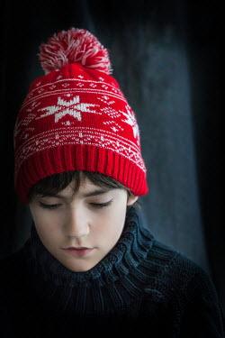 Des Panteva YOUNG BOY WEARING RED BOBBLE HAT Children