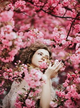 Muna Nazak YOUNG WOMAN STANDING UNDER CHERRY BLOSSOM TREE Women
