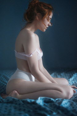 Tatiana Mertsalova YOUNG WOMAN SAT ON BED IN UNDERWEAR Women