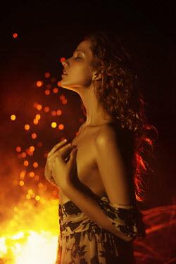 Tatiana Mertsalova YOUNG WOMAN AT NIGHT BY FIRE Women