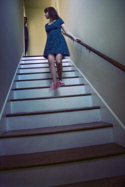 Susan Fox WOMAN WALKING DOWN STAIRS Women