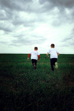Laura Ranftler TWO YOUNG BOYS RUNNING IN PARK Children