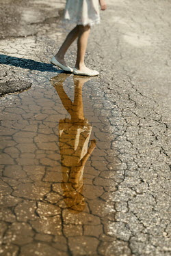 Krasimira Petrova Shishkova young girl reflected in puddle Women