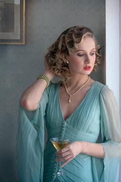 Lee Avison 1930s woman holding a cocktail Women