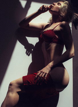 Marta Syrko YOUNG WOMAN IN RED LINGERIE Women