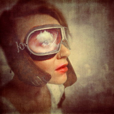 Kamil Vojnar YOUNG WOMAN WEARING VINTAGE AVIATOR GOGGLES Women
