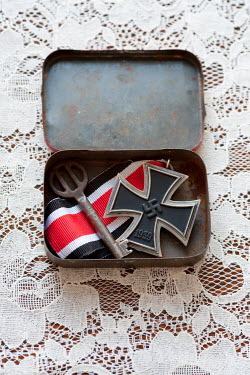 Lee Avison iron cross medal and key in a vintage tin box Flowers