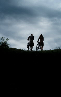 CollaborationJS SILHOUETTED COUPLE WITH BICYCLES Couples