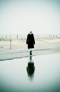 Carmen Spitznagel WOMAN WALKING BY WATER Women